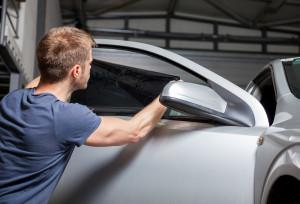 Applying Tinting Foil On A Car Window